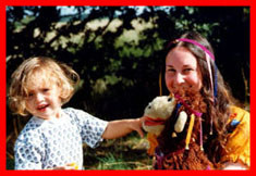Children's clothing and baby clothes from Baby Bird Productions. A photo of Barbara with a child and a puppet.
